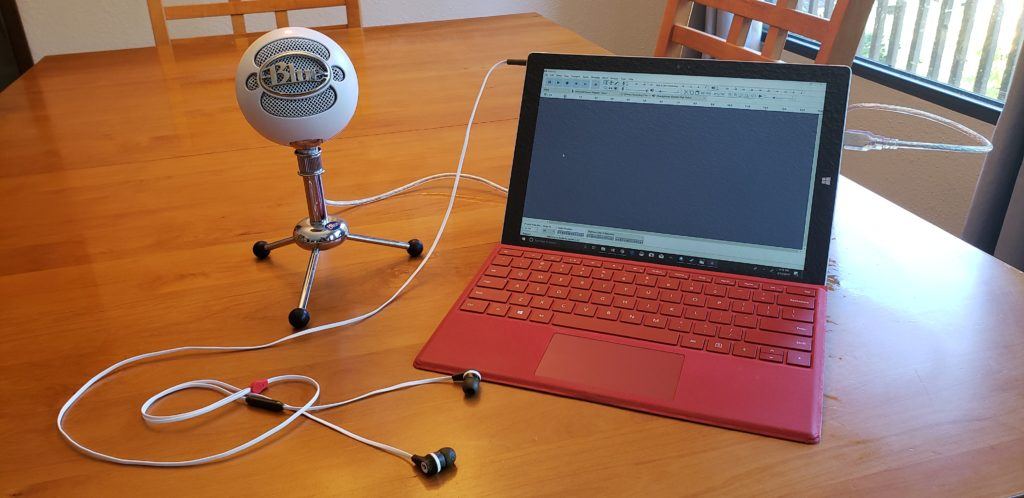 Our microphone, computer and headphones we use for recording.